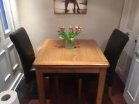 Solid oak extending dining table and 4 chairs (extends to 8 seater)