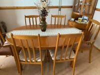 Extending dining table and 6 chairs from Morris of Glasgow