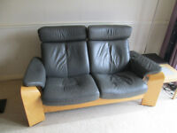 Ekornes Stressless Pegasus two seater reclining sofa in mid-grey leather with headrests.