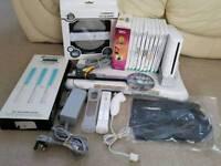 Wii + 11 games inc mario kart + balance board + zumba