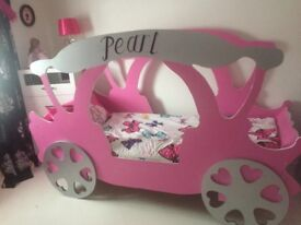 Princess carriage bed excellent condition.Fits single bed. Personalised lettering would paint over.