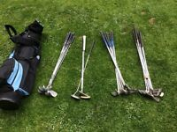 Assorted golf irons and bag