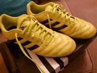 Yellow Adidas all surface football boots.