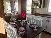 Static caravan holiday homes including 2018&2019 site fees and decking - choice of pitches available