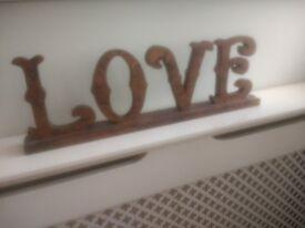 Decorative 'LOVE' gilt lettering