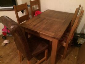 Great dining room table and 5 chairs for sale