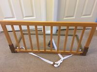 Babydan wooden bed guard in oak. Excellent condition.
