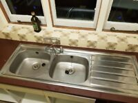 Double sink in stainless steel with tap