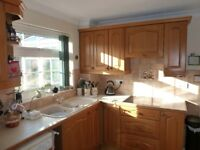 Solid Wooden OAK Kitchen plus Glass fronted cupboard and worktops . Good condition.
