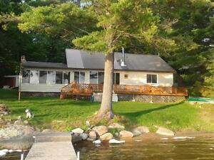 An Great cottage on Skootamatta Lake with a sandy beach!
