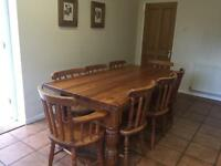 Solid Pine Kitchen Table, 2 carver chairs and 6 chairs.