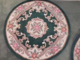 3 round chinese style rugs