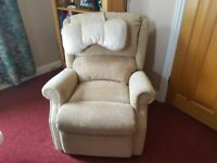 Comfy reclining electric chair.6 months old .new condition. With comfy head rest