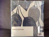 Brand new Marks and Spencer eyelet curtains with blue leaf pattern