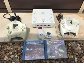 Sega dreamcast with 2 pads and 2 games