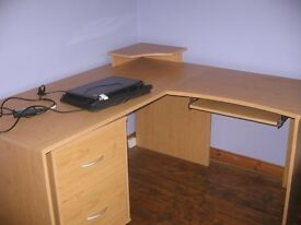 Beech L-shaped desk with pull-out shelf for keyboard and raised platform for monitor -good condition