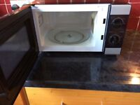 Microwave less than a year old, sparkling clean, barely used