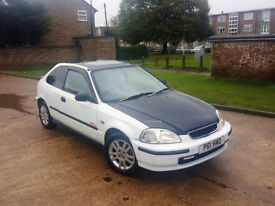 automatic honda civic 1.4 . fully wrapped. carbon fiber. sunroof. long mot. excellent drive. bargain