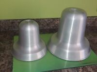 Two bell shaped cake tins