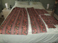 Two pairs of patterned curtains with pelmets and tiebacks