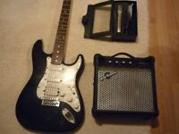 Rocet stratocaster, an amplifier and cordless microphone