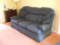 2 Seater Settee in blue fabric with two separate cushions. Supplied by M&S.