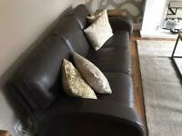 Leather suite by Natuzzi (Three seater and two chairs)