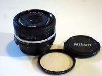 Nikon E 35mm f2.5 wide angle lens. Excellent condition.