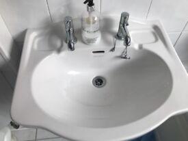 Bathroom wash basin with taps