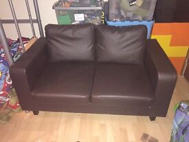 Brown leather 2 seater couch 1 year old hardly been used so in very good condition