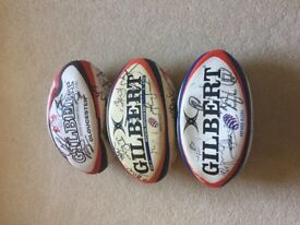 Rugby balls signed by Gloucester Rugby Teams