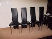 Extending glass toped table and four chairs v.g.c