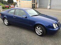 Mercedes 2.3L Coupe, Blue metallic, automatic.