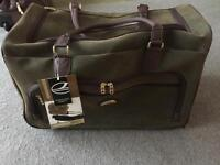 'COMPASS' olive and tan faux suede wheelie holdall