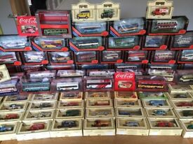 Collection of collectible toy cars and buses