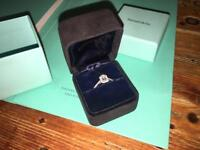 Tiffany engagement ring, emerald cut with halo