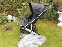 black mamas and papas push chair with rain cover
