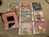 Pink Nintendo ds lite console with games