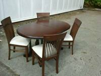 Nice extending dark wood table & 4 high back chairs