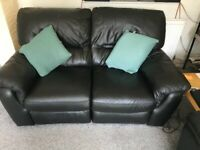 Black Leather Electrically reclining 2 seater sofa -Good condition