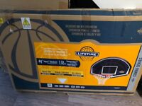 Lifetime basketball net and backboard boxed and never used
