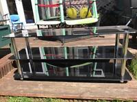 Heavy black glass tv stand
