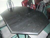 BLACK ASH TABLE PLUS SIX CHAIRS.