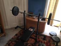 Home gym - bench press and dumbbells