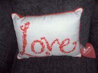 CUSHION LOVE RED/CREAM PINK BNWT APPROX 40CM X30CM oblong.