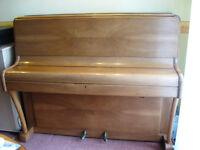Upright Seeger piano in walnut case