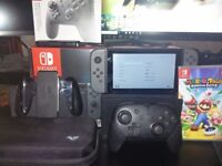Nintendo switch with game and accessories.