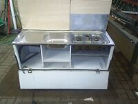 rear kitchen from camping trailer with stainless sink and double burner with grill
