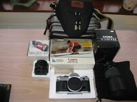 Classic Canon AT1 35mm SLR Manual Camera with Canon FD Auto Lens and accessories.