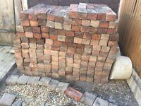 Reclaimed bricks taken from a cellar floor laid circa 1900.